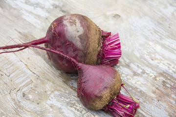 Red beets on a wooden table