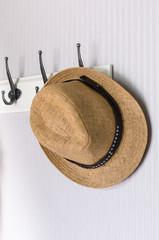 hat hanging on hook