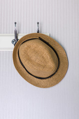 hat hanging on wall