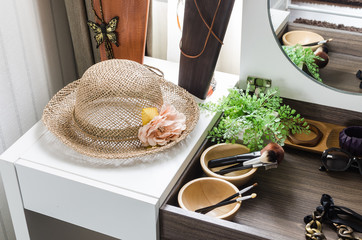 hat on white table with accessories