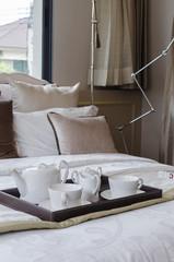 tray of white tea set in bedroom