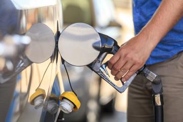 Fueling a car.