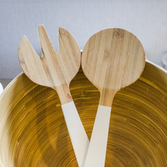 wooden spoon and fork in wood bow