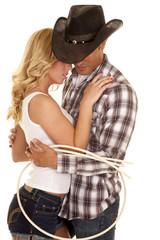 cowboy couple rope around them close