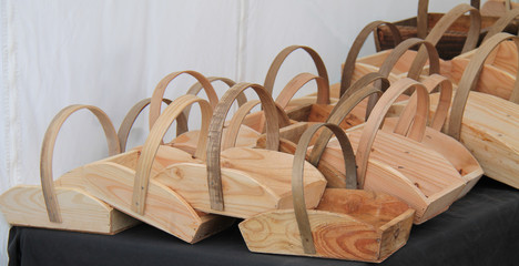 A Display of a Group of Wooden Carrying Baskets.