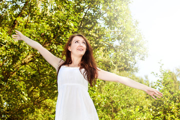 Woman with zest for life has arms outstretched