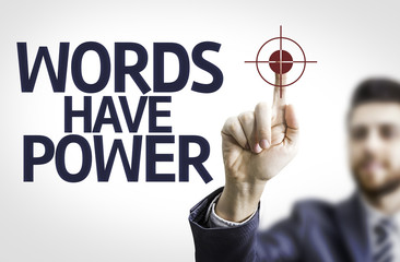 Business man pointing the text: Words Have Power