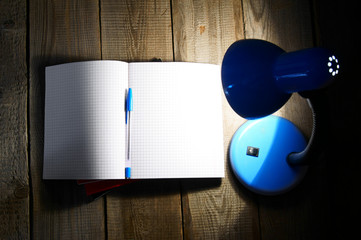 Open writing-book and the fixture.