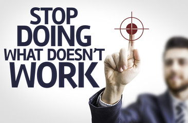 Business man pointing: Stop Doing What Doesn't Work