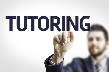 Business man pointing the text: Tutoring