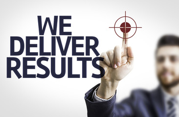 Business man pointing the text: We Deliver Results!