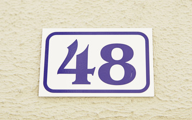 Number forty-eight on the wall of a house