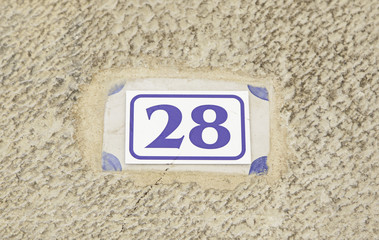 Number twenty eight on a wall of a house