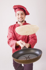 Chef with pan flips pancake
