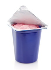 fresh pink berry yogurt in blue plastic pot