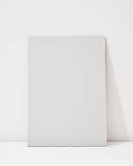 blank poster on the white wall and the floor
