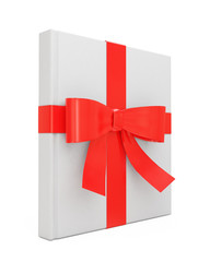 blank white book standing as gift with red ribbon