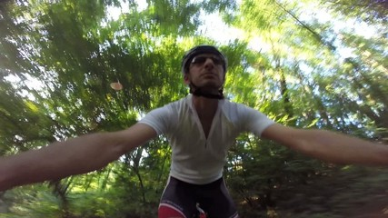 Cyclist rides a mountain bike in a forest. Shots on GoPro