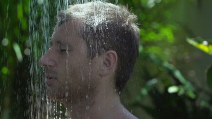 Man getting wet in the shower, slow motion shot at 240fps