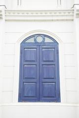 blue window on a white wall