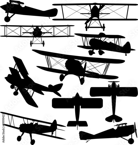 Silhouettes of old aeroplane - contours of biplanes - 69999423