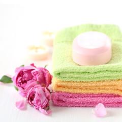 Spa: towels, candles and rose petals