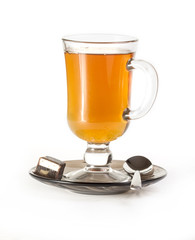 Cup of tea with spoon and candy