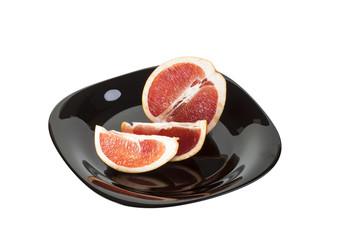 Ripe grapefruits on a plate
