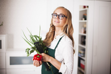 young girl in the kitchen looking for a recipe on tablet