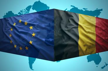 Waving Belgian and European Union flags