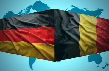 Waving Belgian and German flags