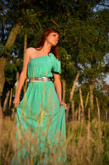 Girl in a blue dress in the spikelets