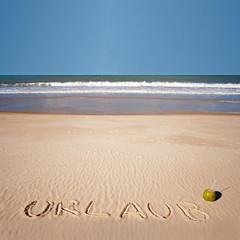 Urlaub geschrieben am Strand