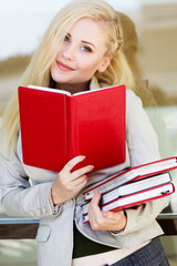 Young beautiful girl with a books