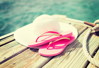 close up of hat and slippers at seaside