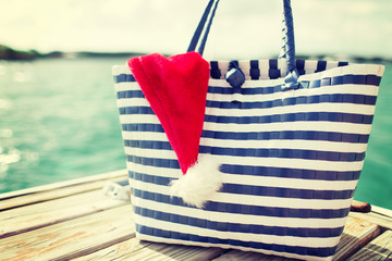 close up of beach bag and santa helper hat