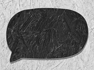 black speech bubble on wooden deck