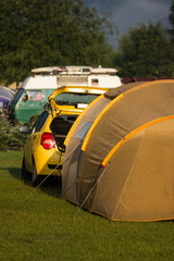 Tents and cars in an outdoor camping site