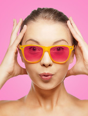 surprised teenage girl in pink sunglasses