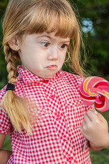 Funny cute girl surprised candy