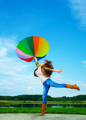 Multicolor umbrella woman jump to sky