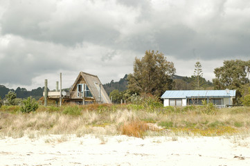 Holiday houses on white sand beach