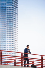 Portrait asian office worker texting mobile phone