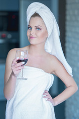 Lady holding glass of wine relaxing