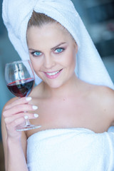 Woman in White Bath Towel Holding Glass of Wine