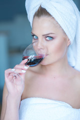 Woman in Bath Towel Drinking Glass of Red Wine
