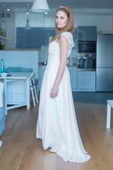 Woman Wearing Wedding Dress Standing in Kitchen