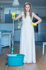 Stern Woman Wearing Gown and Holding Mop