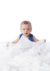Baby playing with lots tissue papers