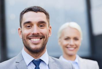 close up of smiling businessmen